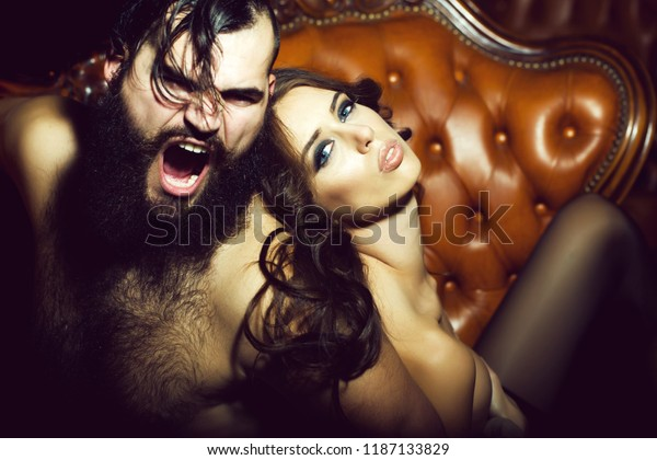 Young couple with sexy girl and handsome shouting man on sofa. Adult people, relations