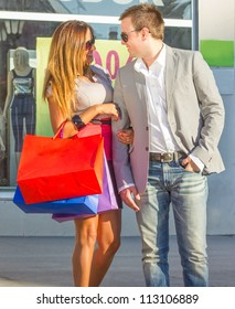 Young Couple with Shopping Bags.