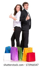 Young couple with shopping bags on a white background