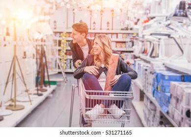 young couple shopping for DIY tools at hardware store.cheerful young couple shopping in hardware store