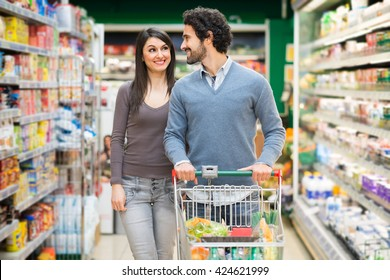 Young couple shopping in a grocery store