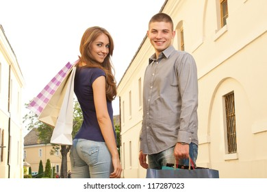 Young couple in shopping, looking in the camera