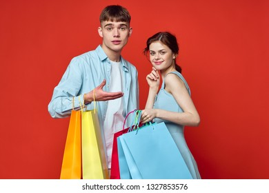 young couple with shopping packages