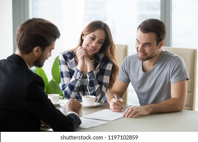 Young couple signs contract with realtor, banker. Family buying or renting house, apartment, real estate, taking bank loan. Husband, customer sign document