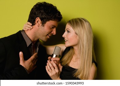 Young couple singing a duet