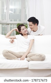 Young couple sitting in couch