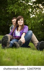 Young couple sitting on ground