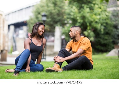young couple sitting in the park together