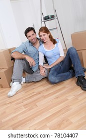 Young couple sitting in their new house