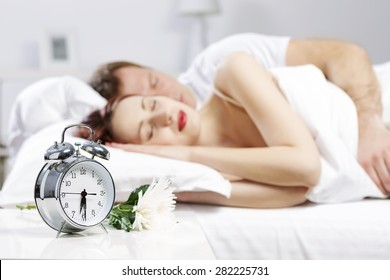 Young couple sleeping peacefully in the bed