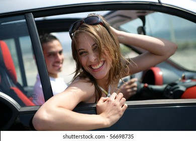 Young couple smiling in a car
