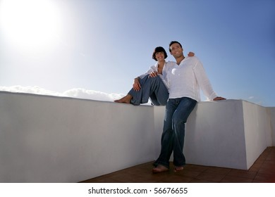 Young couple smiling on a terrace