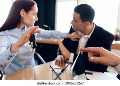 Young couple solves issue of division of property in attorney's office for divorce. Concept of property section under divorce. Property division.