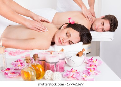 Young Couple In Spa Salon Getting Back Massage