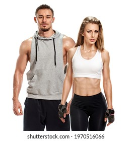 Young couple in sportswear posing after exercise isolated on white background, healthy lifestyle, the need for physical activity in the modern world
