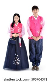 Young couple standing with both hands together in korean traditional dress