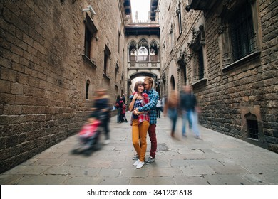 Young couple standing and hugging. Gothic Quarter in Barcelona, Spain, on October 25, 2015.