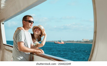 Young couple standing on board the ship