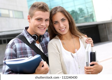 Young couple standing outside the university building