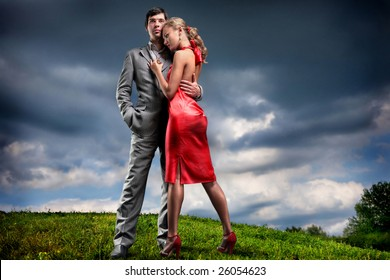 Young couple with storm cloudy sky