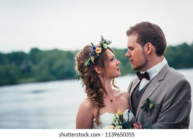 young couple in the style of provence on background of river.