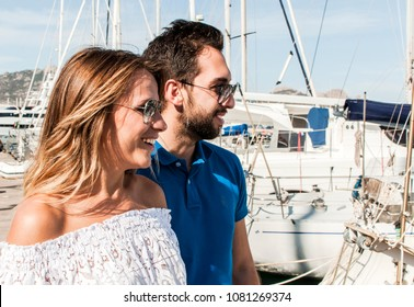 Young couple in sunny harbor, summer, vacation, travel