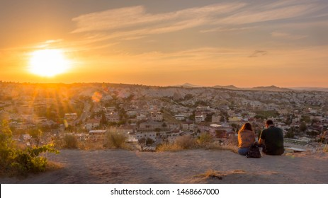 A young couple at sunset, looking over Goreme, in Kapadokya
