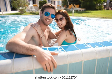 Young couple in the swimming pool,  swim,