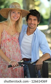 Young couple taking a bike ride