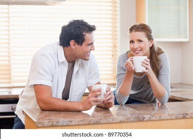 Young couple taking a coffee break together