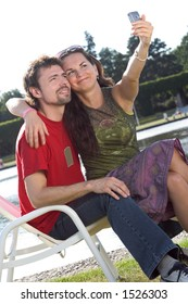 Young couple taking photo with a mobile phone.