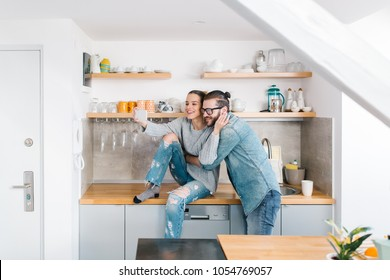 Young couple taking selfie in the kitchen