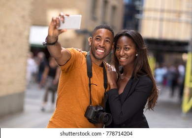 young couple taking a selfie together