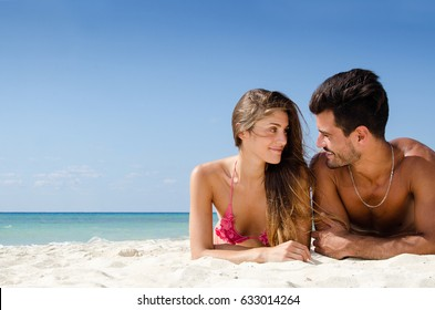 Young couple taking sun on the beach