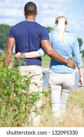 Young couple taking a walk outside.