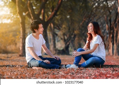 young couple talking and laghing in the park