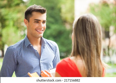 Young couple talking outdoors