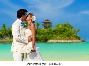 Young couple at their beach wedding in Sentosa SIngapore