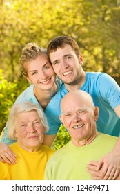 Young couple and their grandparents outdoors