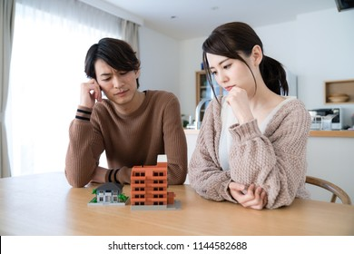 Young couple thinking about residence.