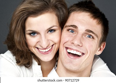 young couple together on black background