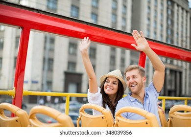 Young couple at the tour bus