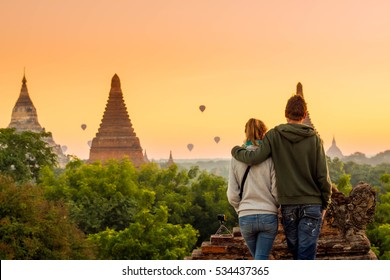 Young couple tourism see view from top of a pagoda in Bagan, Travel couple in Myanmar