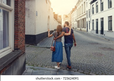 Young couple of tourists walking the streets of a European city.