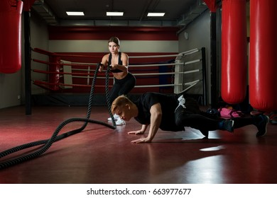 Young couple training in a gym