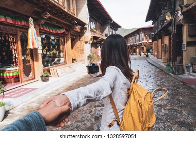 Young couple traveler walking at Shangri-la old town, Travel lifestyle concept