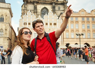 young couple travelers walking on a street of European city. sightseeing traveler. Prague, Old Town Square