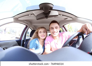 Young couple travelling by car