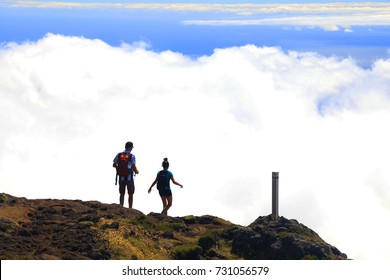 Young couple trekking on Pico volcano (2351m) on Pico Island, Azores, Portugal, Europe