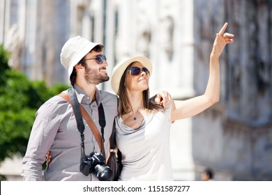 Young couple of turists in the city